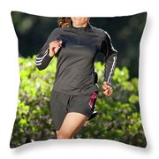 An Athletic Woman Trail Running Throw Pillow