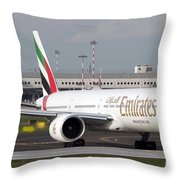 An Emirates Boeing 777 At Milano Throw Pillow