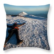 An Exhausted Climber Lies On The Summit Throw Pillow