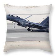 An F-15c Eagle Landing On The Runway Throw Pillow