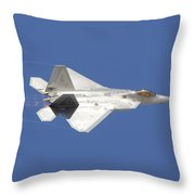 An F-22 Raptor In Flight Over Nellis Throw Pillow