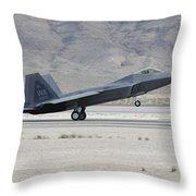An F-22 Raptor Landing On The Runway Throw Pillow