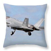 An F-35a Taking Off From Eglin Air Throw Pillow