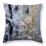 An Ice Climber Ascends A Frozen Throw Pillow