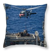 An Mh-60s Sea Hawk Delivers Supplies Throw Pillow