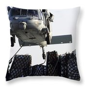 An Mh-60s Sea Hawk Picks Up Supplies Throw Pillow