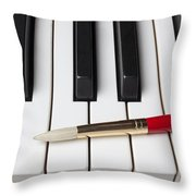 Artist Brush On Piano Keys Throw Pillow