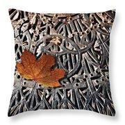 Autumn Leave On Iron Grate Throw Pillow