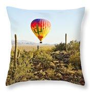 Balloon Ride Over The Desert Throw Pillow