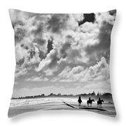 Beach Riders Throw Pillow by Dave Bowman