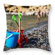Beach Toys Throw Pillow by Luis Alvarenga