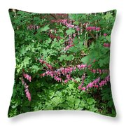 Bed Of Bleeding Hearts Throw Pillow