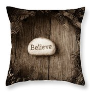 Believe In Text In The Center Of A Christmas Wreath Throw Pillow