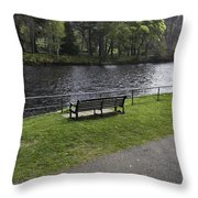 Bench On Shore Of River Ness In Inverness Throw Pillow
