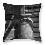 Black And White Photograph Of Vintage Creamery Can By The Old Homestead In 1880 Town Throw Pillow