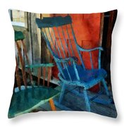 Blue Chair Against Red Door Throw Pillow