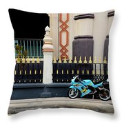 Blue Yellow Sporty Motorcycle Parked On Pavement Throw Pillow