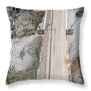 Boots On Narrow Swing Bridge Over White Water Throw Pillow