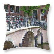 Bridge Over Canal With Bicycles  In Amsterdam Throw Pillow