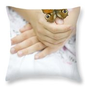 Butterfly Resting On A Girls Hand Throw Pillow