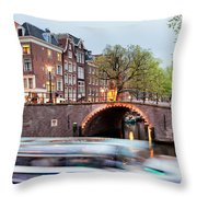 Canal Bridge And Boat Tour In Amsterdam At Evening Throw Pillow