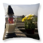 Candle Lit In Memory Of The Victims Of Auschwitz Birkenau Poland Throw Pillow