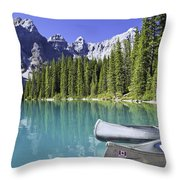 Canoes In Moraine Lake And Valley Of Throw Pillow