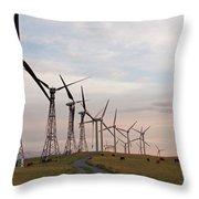 Cattle Graze In Field Next To Windmills Throw Pillow