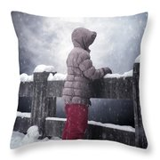 Child In Snow Throw Pillow