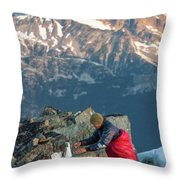 Climber Lights His Ultralight Stove Throw Pillow