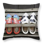 Clogs In A Rack Throw Pillow