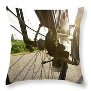 Close Up Of Wheel Of Bicycle On Road Throw Pillow