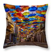 Colorful Floating Umbrellas Throw Pillow by Marco Oliveira