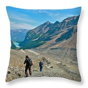 Couple Hiking On Plain Of Six Glaciers Trail  In Banff Np-albert Throw Pillow