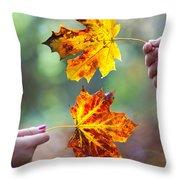 Couple Holding Autumn Leaves Throw Pillow
