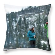 Couple Standing By A Campfire Throw Pillow