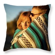 Couple Wraps Themselves In A Blue Throw Pillow