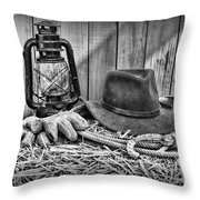 Cowboy Hat And Rodeo Lasso In A Black And White Throw Pillow by Paul Ward