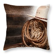 Cowboy Hat On Hay Bale Throw Pillow by Olivier Le Queinec
