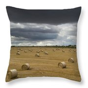 Dark Storm Clouds Over A Field With Hay Throw Pillow