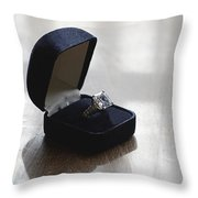 Diamond Ring On A Black Box Throw Pillow