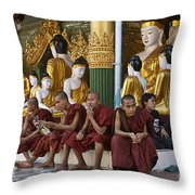 faithful Buddhist monks siiting around Buddha Statues in SHWEDAGON PAGODA Throw Pillow