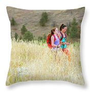 Female Hikers Walk On A Trail Throw Pillow
