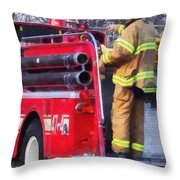 Fireman On Back Of Fire Truck Throw Pillow