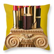 Five Red Lipstick Tubes On Pedestal Throw Pillow by Garry Gay