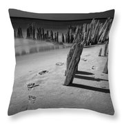 Footprints In The Sand Among The Pilings Throw Pillow