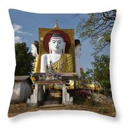 four sitting Buddhas 30 metres high looking in four points of the compass at Kyaikpun Pagoda Throw Pillow