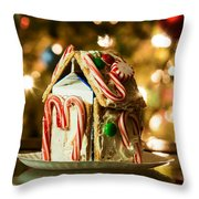 Gingerbread House Against A Background Of Christmas Tree Lights Throw Pillow