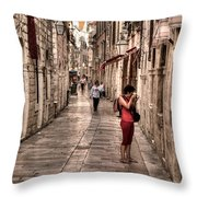 Girl In Red In The White Streets Of Dubrovnik Throw Pillow