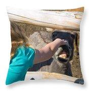 Girl Pets Donkey Throw Pillow